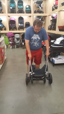 rick picking out stroller